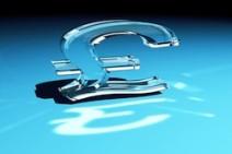 Glass pound sterling symbol over blue gradient background