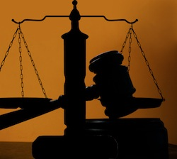 judges court gavel silhouette on blue background